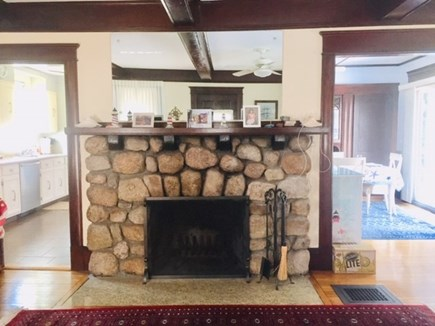 Falmouth Heights Cape Cod vacation rental - Original stone (wood burning) fire place in living room.