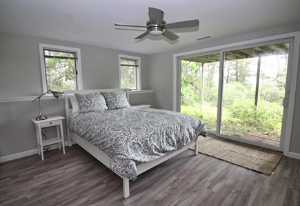 Wellfleet Cape Cod vacation rental - Lower level bedroom with queen bed and slider to patio