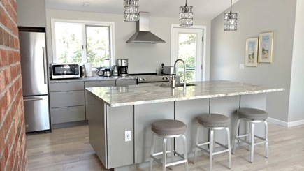 Wellfleet Cape Cod vacation rental - Fully-equipped kitchen has an island with breakfast bar