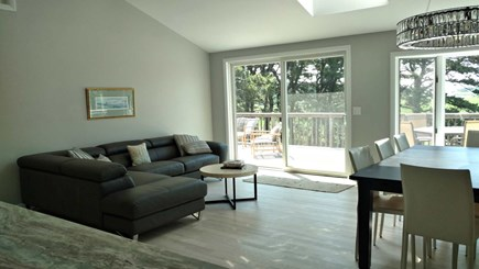 Wellfleet Cape Cod vacation rental - Living room with sofa and slider to deck with wonderful views