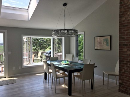 Wellfleet Cape Cod vacation rental - Dining area next to living area with marsh views