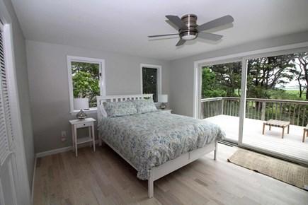 Wellfleet Cape Cod vacation rental - First floor bedroom with queen bed and slider to deck