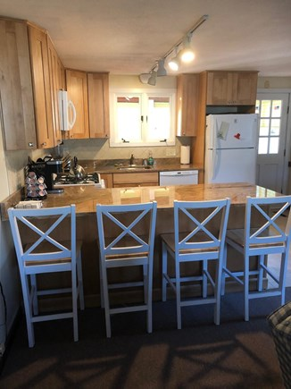South Yarmouth Cape Cod vacation rental - Eat-in Kitchen with granite counter tops, gas stove, microwave.