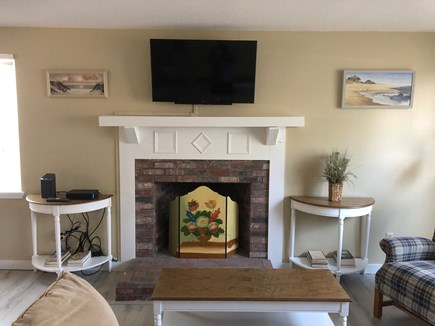 South Yarmouth Cape Cod vacation rental - Cozy living room with working fireplace