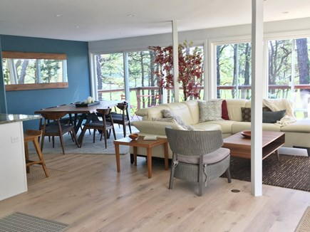 Wellfleet Cape Cod vacation rental - Open living area has natural light and sliders to front deck.
