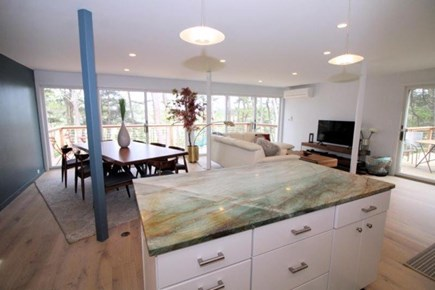 Wellfleet Cape Cod vacation rental - Kitchen with island opens to dining/living area and front deck.