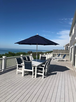 Dennis Cape Cod vacation rental - Deck with table and lounge chairs.