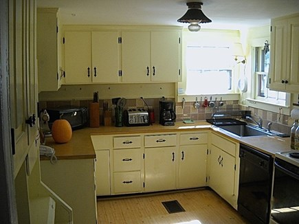 Wellfleet, Pine Point Cape Cod vacation rental - Fully equipped kitchen with laundry and bathroom adjacent.