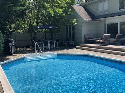 East Falmouth Cape Cod vacation rental - Other end of the pool with dining and seating areas