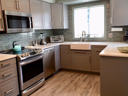 Truro Cape Cod vacation rental - New kitchen with induction range. All new appliances