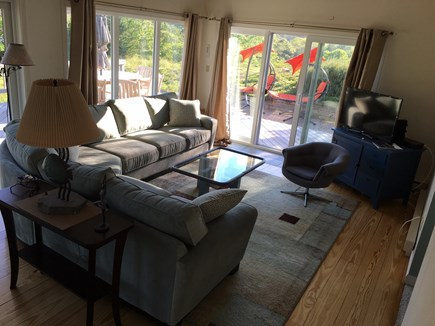 Truro Cape Cod vacation rental - Living room with wrap around deck and windows