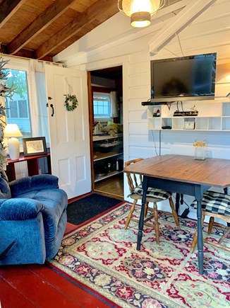Wellfleet Cape Cod vacation rental - Sun porch with TV and dining table.