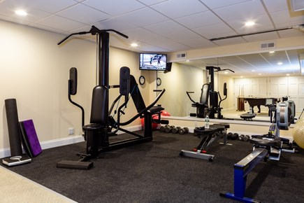 Provincetown Cape Cod vacation rental - Free weights and bench and universal plus rowing machine