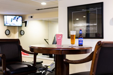 Provincetown Cape Cod vacation rental - High table and two chairs in game room