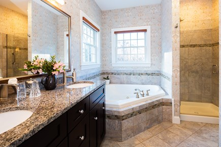 Provincetown Cape Cod vacation rental - Main bath with 2 sinks, jetted tub and glass shower enclosure
