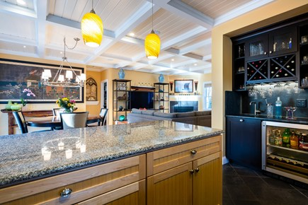 Provincetown Cape Cod vacation rental - Wet bar and beverage fridge, view of dining table, 6 chairs