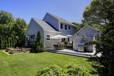 Provincetown Cape Cod vacation rental - Full view of backyard, home, outdoor shower and raised beds