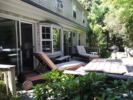 Wellfleet Cape Cod vacation rental - Deck with charcoal grill, lounge chairs and picnic table