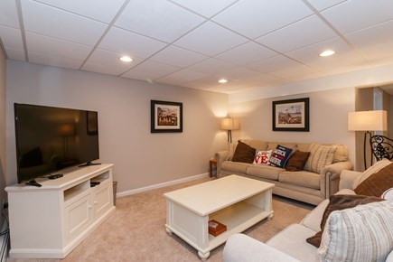 Mashpee, Popponesset Cape Cod vacation rental - Lower level recreation room with TV, ping pong, washer/dryer