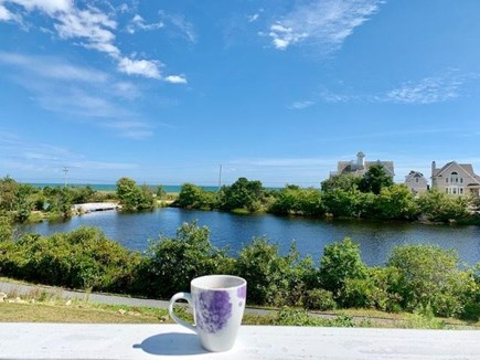 Mashpee, Popponesset Cape Cod vacation rental - Relax and unwind with a cup of coffee on the large deck.