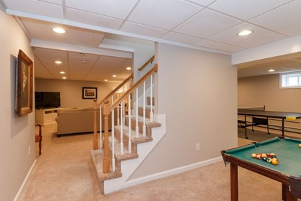 Mashpee, Popponesset Cape Cod vacation rental - Lower level with TV area, ping pong table, mini-pool table