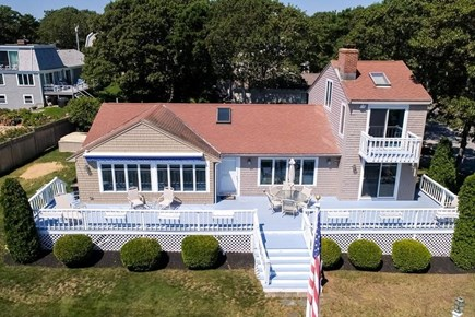 Mashpee, Popponesset Cape Cod vacation rental - Deck now has 2 dining tables, conversational seating, grill