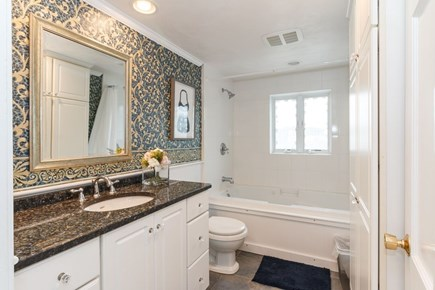 Mashpee, Popponesset Cape Cod vacation rental - Main bathroom off the hallway with shower/tub