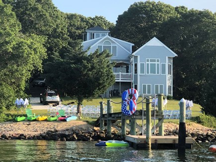 Bourne, Buzzards Bay Cape Cod vacation rental - View of back of the house from the bay.  Permanent dock w/ float