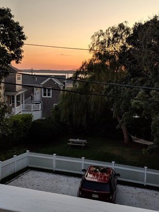 Falmouth Heights Cape Cod vacation rental - Sunset view from balcony or enjoy fenced in yard with hammock.