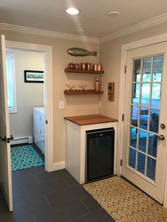 Brewster Cape Cod vacation rental - Wet Bar Area with washer/dryer mudroom 1/2 bath