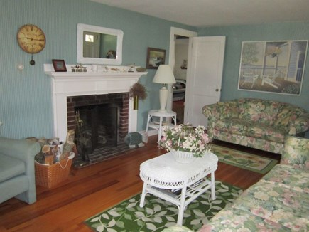 South Yarmouth Cape Cod vacation rental - Living room with fireplace and Cape Cod decor