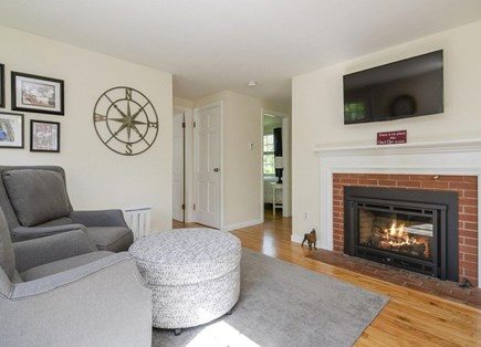 Orleans Cape Cod vacation rental - Sitting room with comfortable seating in front of gas fireplace