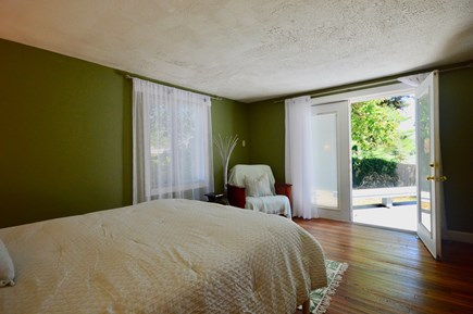 Eastham Cape Cod vacation rental - Main house queen bedroom doors open onto the deck