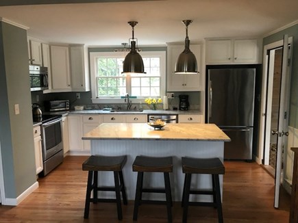 Harwich Port Cape Cod vacation rental - Fully stocked kitchen opens to living room.