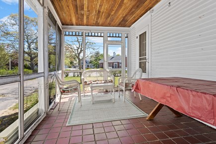 Harwichport Center Cape Cod vacation rental - Screened in Porch looking at Doane Park