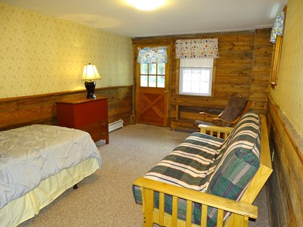 Orleans Cape Cod vacation rental - Downstairs bedroom with twin, futon and door to back yard