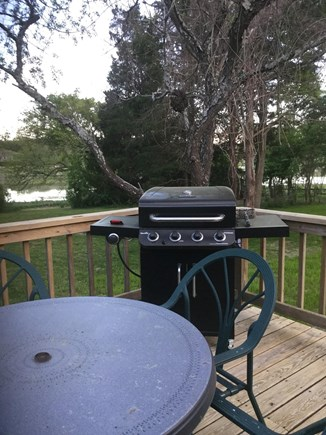 Orleans Cape Cod vacation rental - Deck with grill and table and chairs with marsh view