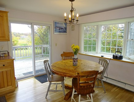 Orleans Cape Cod vacation rental - Dining room with bay window and slider to deck