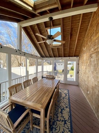 Mashpee, Popponesset Cape Cod vacation rental - Al fresco dining in the screen room.