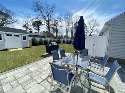 Mashpee, Popponesset Cape Cod vacation rental - Private yard with shed for bikes, outdoor shower, and dining.