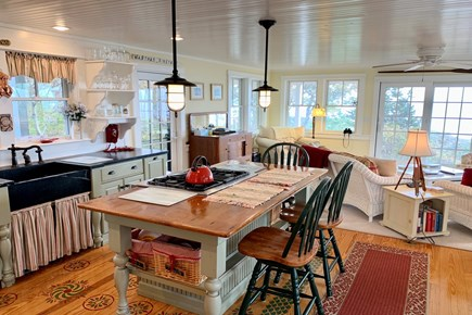 Hyannis Cape Cod vacation rental - Kitchen island and living area behind