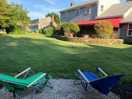 Falmouth Village Cape Cod vacation rental - Large, private backyard for fun! Wiffle ball? (Firepit not shown)