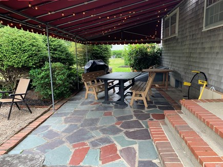 Falmouth Village Cape Cod vacation rental - Covered porch w/ lights - perfect for nights and rainy days.