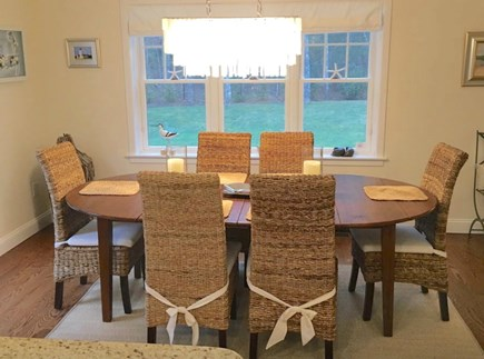 Mashpee Cape Cod vacation rental - Dining area off living room and kitchen with access to deck/BBQ