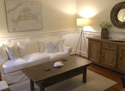 Mashpee Cape Cod vacation rental - Sitting room off of kitchen with couch, chair, desk and armoire