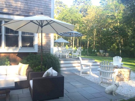 Mashpee Cape Cod vacation rental - Large, fenced-in backyard with 2 patios, deck, fire pit, seating