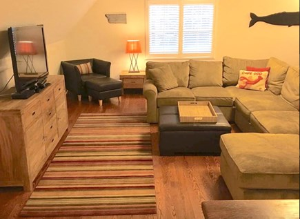 Mashpee Cape Cod vacation rental - Large family room with half bath above garage