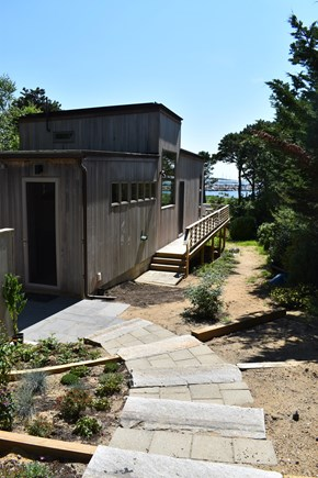 Wellfleet Cape Cod vacation rental - The house, as seen from driveway, and the harbor beyond.