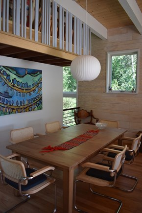 Wellfleet Cape Cod vacation rental - Dining area, with an expandable table and a view of the water