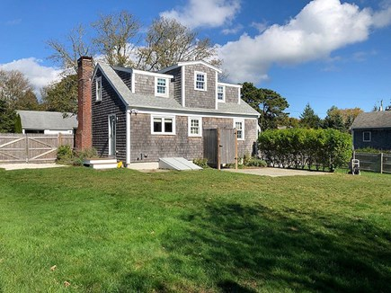 Chatham Cape Cod vacation rental - View of the Back of the Home With A Large Yard and Patio